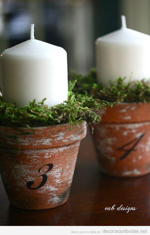 Velas en macetas de terracota para decorar boda