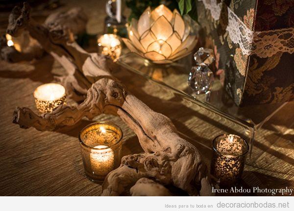Decoración de mesa con madera y velas, estilo indio